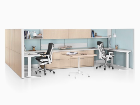 Ethospace shared workspace with wood panels, storage units, and black Embody ergonomic desk chairs.