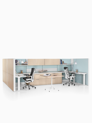 Two Ethospace System workstations with sit-to-stand desks and Embody office chairs. Select to go to the Ethospace product page.