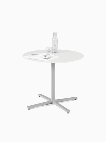A white, round, standard height Everywhere Table with a grey column. Select to go to the Everywhere Tables product page.