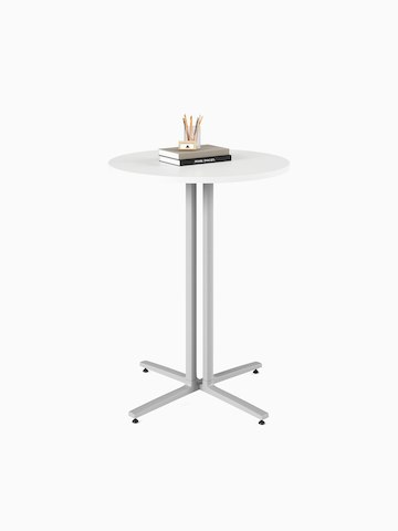 A white, round, standing height Everywhere Table with grey legs. Select to go to the Everywhere Tables product page.