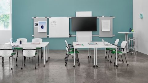 A workshop setting with Everywhere training tables, Exclave boards, and white and green Keyn Chairs.