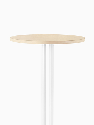A small round Everywhere Table with a light veneer top. Select to go to the Everywhere Tables product page.