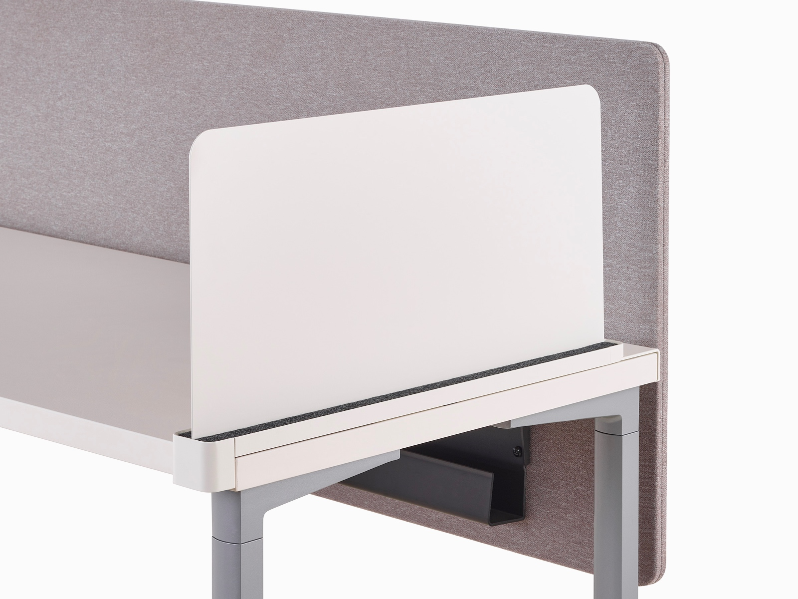 Close-up of a white Ubi slim metal delineation side screen with a cable trough found attached to a privacy screen beneath an Everywhere Table.