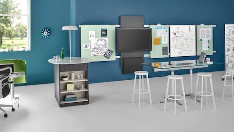 A wall-hung media tile and wall-hung display boards from Exclave promote idea sharing in a collaboration space.