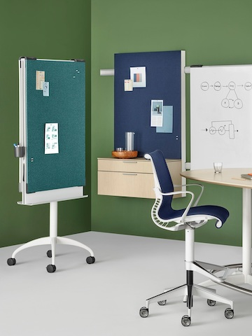A collaboration space containing a blue Setu Stool and an Exclave mobile cart, stowage unit, and whiteboard.