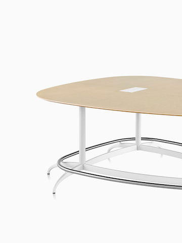 A teardrop-shaped Exclave conference table. Select to go to the Exclave product page.