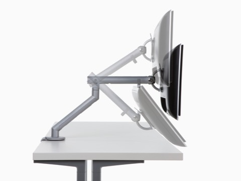 Profile view of an adjustable Flo Monitor Arm in three different positions.