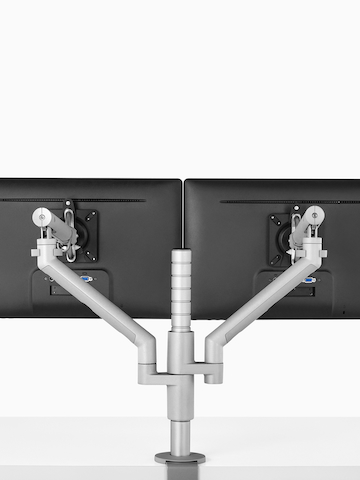 A single-post Flo Monitor Arm capable of supporting up to four monitors or laptops. Select to go to the Flo Modular product page.