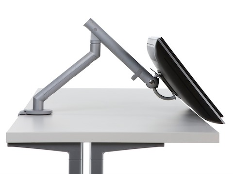 Profile view of a surface-attached Flo Monitor Arm adjusted at a low angle.
