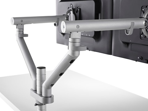 Close-up of a dual Flo Monitor Arm with two monitors attached.