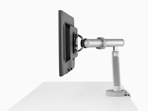 Profile view of a surface-attached Flo Monitor Arm holding a single monitor.