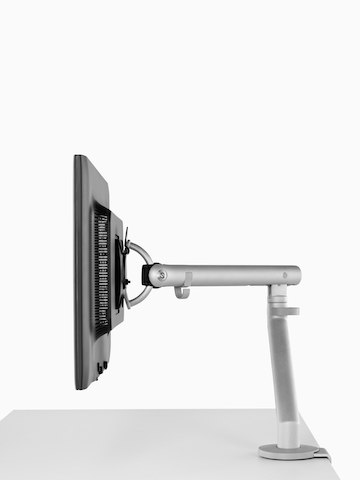 An adjustable Flo Monitor Arm attached to a work surface.