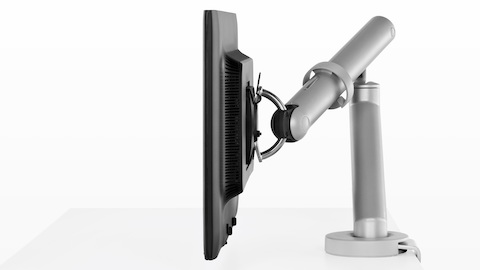 Profile view of a single monitor supported by an adjustable Flo Monitor Arm.