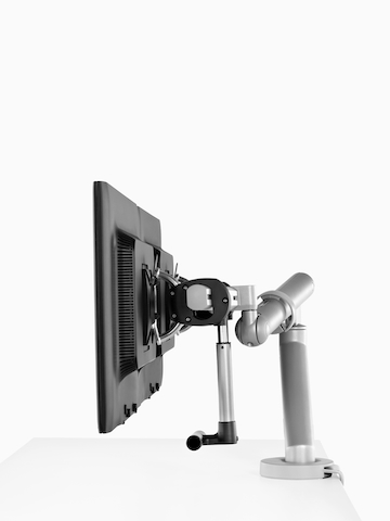 Side-by-side monitors supported by a sturdy Flo Monitor Arm.