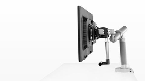 Profile view of side-by-side monitors attached to the crossbar of a Flo Plus Dual Monitor Arm.