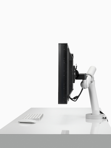 A single monitor supported by a heavy-duty version of the Flo Monitor Arm.