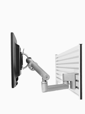 An adjustable Flo Monitor Arm designed for panel-mounted rail systems.