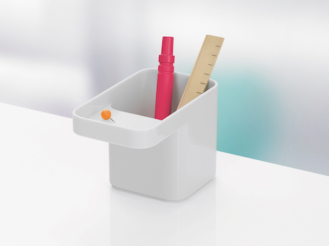 A white Formwork Pencil Cup containing a marker and ruler.