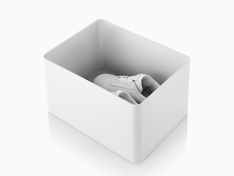 A white Formwork Tall Bin containing running shoes.