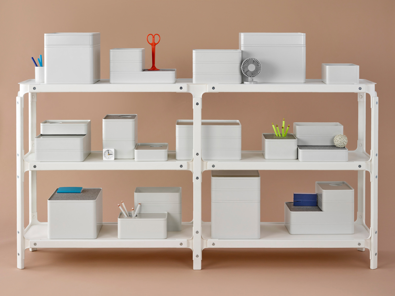 Several Formwork desktop storage elements on a three-shelf Magis Steelwood Shelving System.