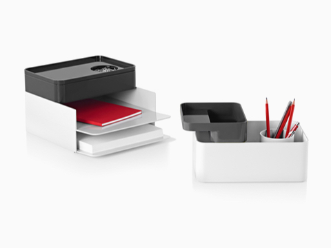 Two configurations of Formwork stackable desktop storage items, including paper trays, large and small boxes, and a pencil cup.