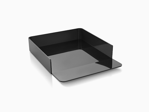 Angled view of a black Formwork Paper Tray with a gently sloped lip.