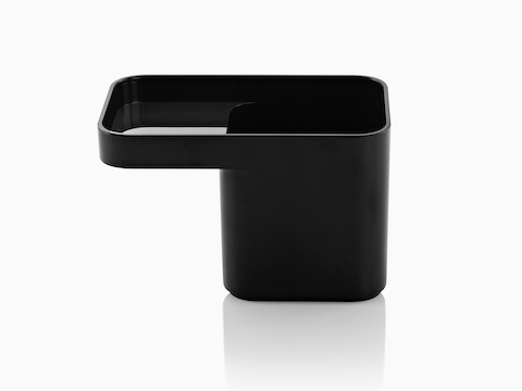 Profile view of a black Formwork Pencil Cup with a deep rear compartment and cantilevered front compartment.