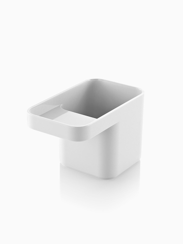 A white Formwork Pencil Cup with two compartments. Select to go to the Formwork Pencil Cup product page.