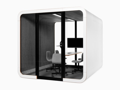 A white Framery 2Q Office Pod with five gray chairs around a table and display monitor.