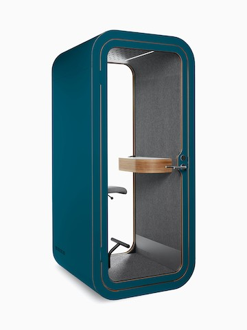 A teal Framery O Office Phone Booth with a gray fabric interior, small shelf, and stool.