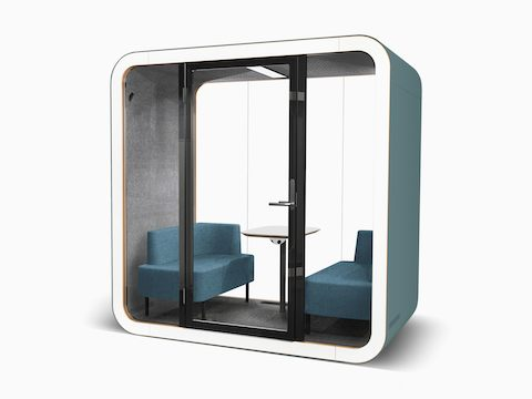 A teal Framery Q Office Pod with a table, power access, and sofas.