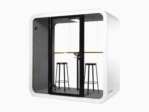 A white Framery Q Office Pod with two stools and a table.