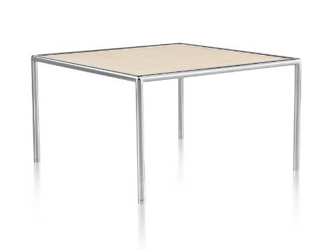 A square Full Round Table with a tan top and tubular metal frame.