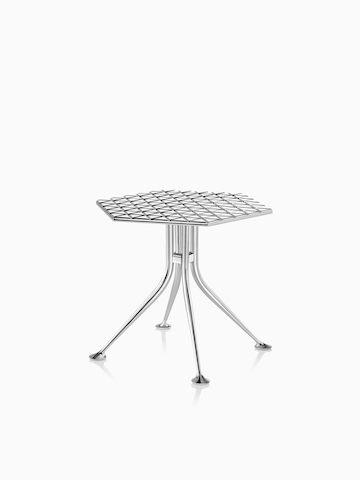 A Girard Hexagonal Table with a polished aluminum top. Select to go to the Girard Hexagonal Table product page.