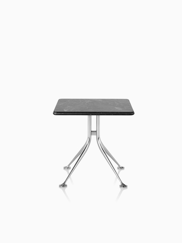 A square Girard Splayed Leg Table with a black top.