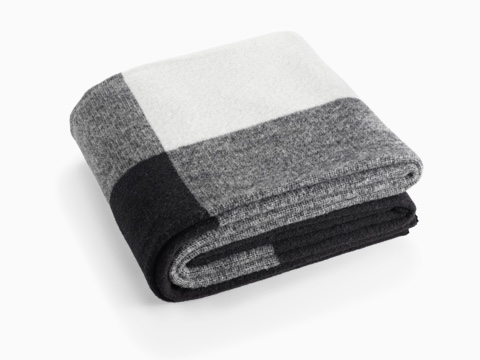 A folded Girard Throw blanket in shades of white, gray, and black.