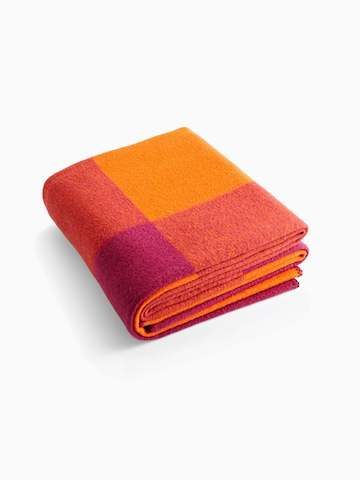 A folded throw blanket. Select to go to the Girard Throw product page.