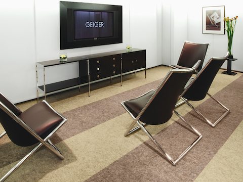 An office lounge featuring an H Frame Credenza and four Scissor Chairs.