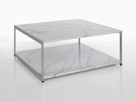 A rectangular H Frame coffee table with two stone tiers.