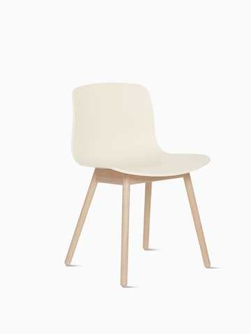 White About A Chair with sled base, viewed at an angle.