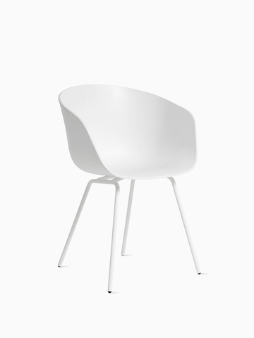 Green About A Chair with black wooden base, viewed at an angle.