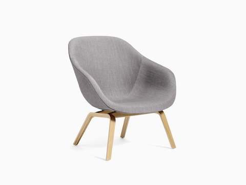 Gray About A Lounge Chair with wooden base, viewed at an angle.
