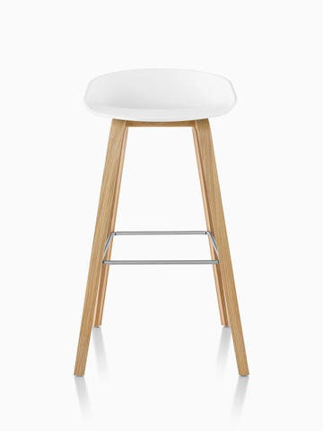 White About A Stool with wooden base, viewed from the front.