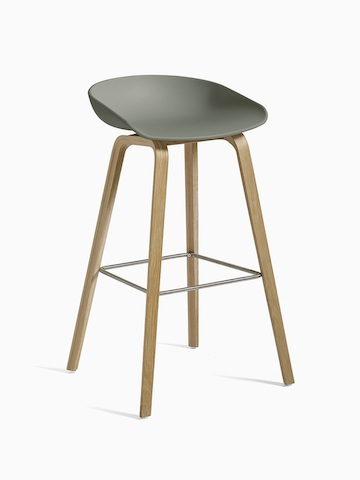 Green About A Stool with wooden base, viewed at an angle.
