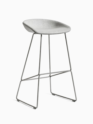 gray About A Stool with metal base, viewed at an angle.
