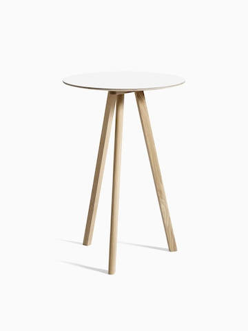 White Copenhague Bistro Table with wooden legs, viewed at an angle.