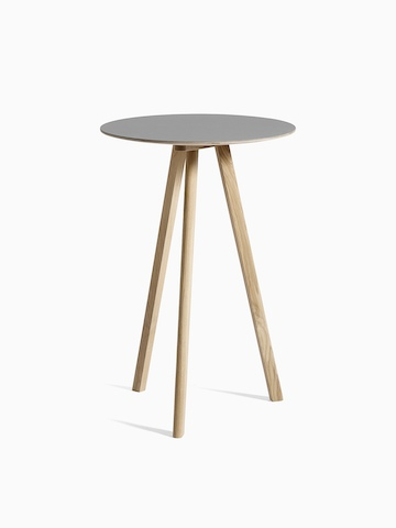 gray Copenhague Bistro Table with wooden legs, viewed at an angle.
