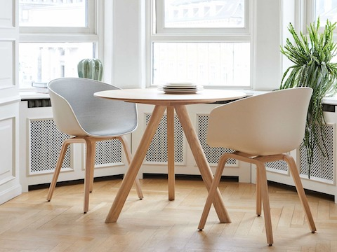 Round members of the Copenhague Table family creatively stacked on top of one another.