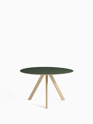 A black Copenhague Table with oak base, with hover image tabletop in off-white. Select to go to the Copenhague Table product page.