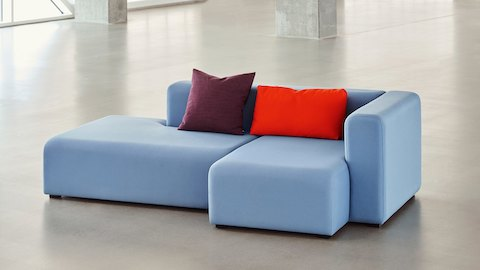 Blue Mags Sectional Sofa 2-piece combination, staged in large open room.